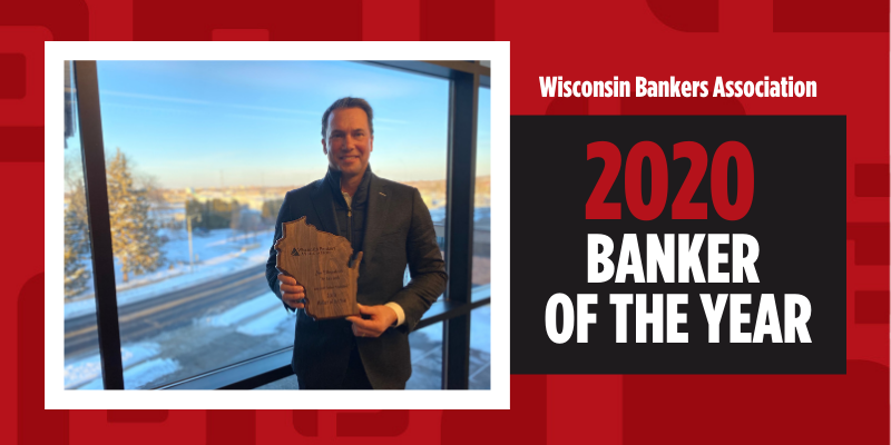 Jim Hegenbarth holds award for winning Wisconsin Bankers Association 2020 Banker of the Year